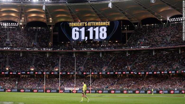 Covid surge after some Australians break lockdown to celebrate country's biggest football event of the year