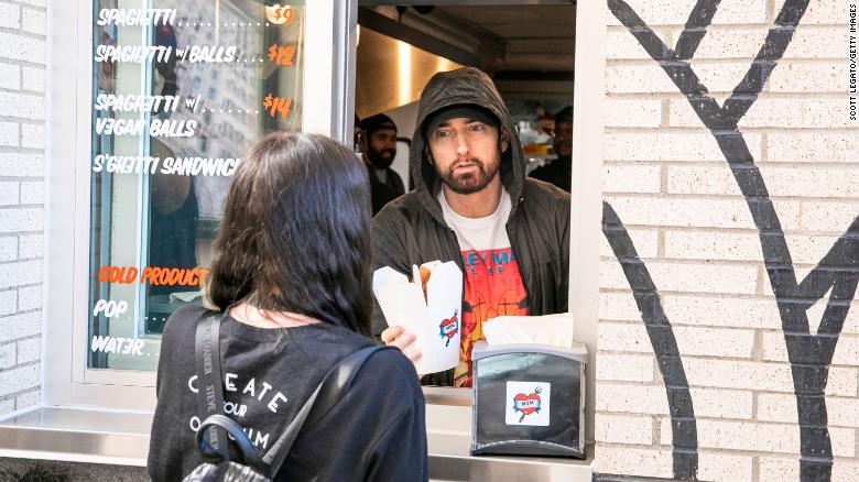 Eminem served pasta to guests at his restaurant opening