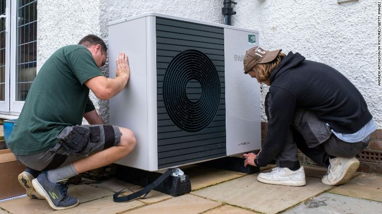 An air source heat pump unit is installed at a 1930s-built house in Folkestone, England, on September 20, 2021.