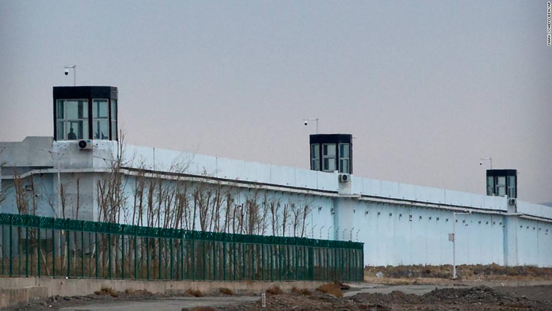 A guard patrols Number 3 Detention Center in Dabancheng in western China's Xinjiang Uyghur Autonomous Region.