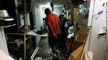 A Queens resident walks through his damaged basement-level apartment after flooding from the remnants of Hurricane Ida in September.