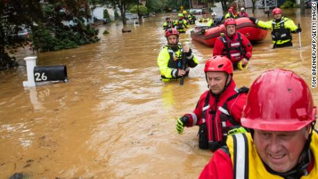 Members of the New Market Volunteer Fire Company perform a secondary search in Helmetta, New Jersey, during an evacuation effort following a flash flood from Tropical Storm Henri.