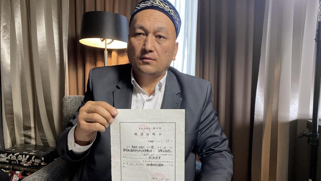 Omir Bekali holds his official form stating he was released from detention on bail in November 2018, pending trial.