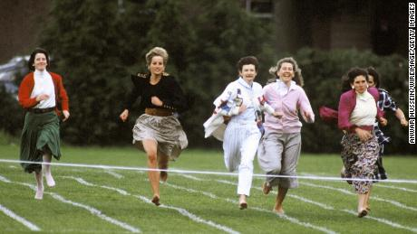 Diana runs barefoot as she takes part in the Mother's race during Prince Harry's school sports day on June 11, 1991.