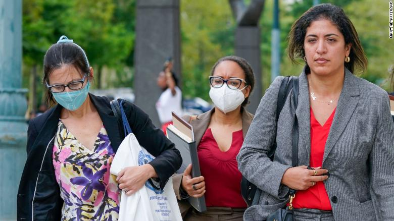 Assistant United States Attorneys Elizabeth Geddes, left, Maria Cruz Melendez, second from left, and Nadia Shihata, second from right, leave Brooklyn federal court on Thursday, Aug. 19, 2021.