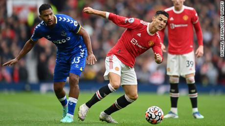 Ronaldo battles for possession with Jose Salomon Rondon of Everton.