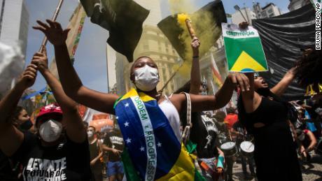 Demonstrators in Rio de Janeiro, Brazil, take to the streets against President Jair Bolsonaro on October 2.