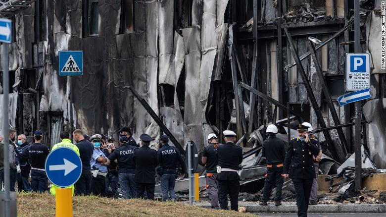 Small plane crashes into empty building outside Milan, all 8 onboard die