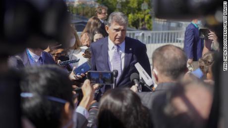 Sen. Joe Manchin, D-W.Va., speaks to members of the media outside the Capitol in Washington on Thursday, September 30, 2021.