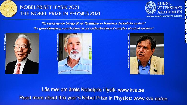 The co-winners of the 2021 Nobel Prize in physics (from left) Syukuro Manabe, Klaus Hasselmann and Giorgio Parisi on a screen at the Royal Swedish Academy of Sciences in Stockholm, on October 5.