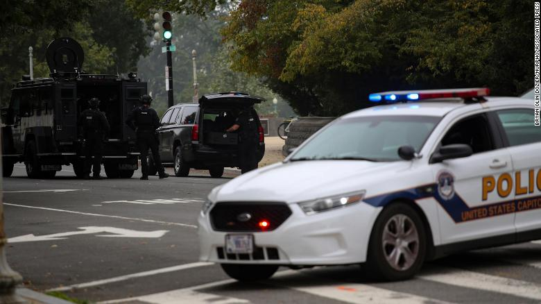Capitol Police take a suspect into custody from a 'suspicious vehicle' in front of the Supreme Court