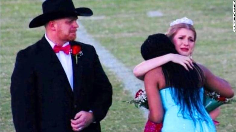 Brittany Walters hugs Nyla Covington after she passed along her crown.