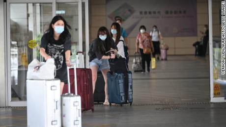 Travelers at Shenzhen Bay Immigration Control Point in Hong Kong on September 15.