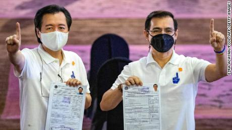 Manila Mayor Francisco Domagoso, right, known by his screen name Isko Moreno, and his running mate for vice president Willie Ong in Manila on October 4.