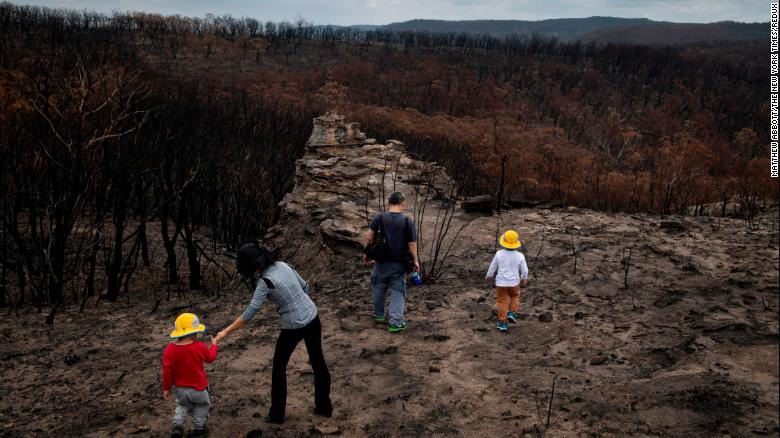 A family from Sydney, Australia, visiting an area devastated by bush fires in the New South Wales region of Australia on Jan. 28, 2020.