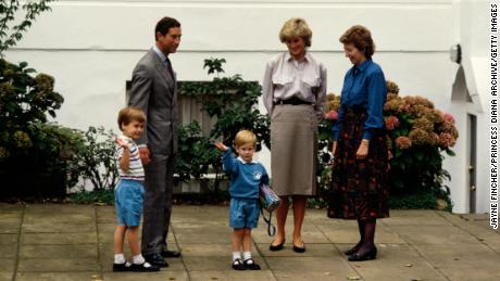 Prince Charles, Princess Diana and Prince William attend Prince Harry's first day at Mrs Mynors' nursery school in London in 1987.