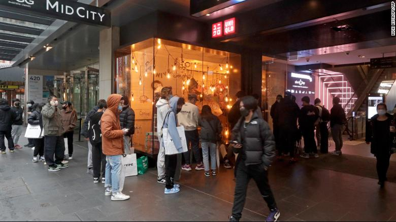 Customers line up to enter a store in Sydney on October 11 after more than 100 days of lockdown.