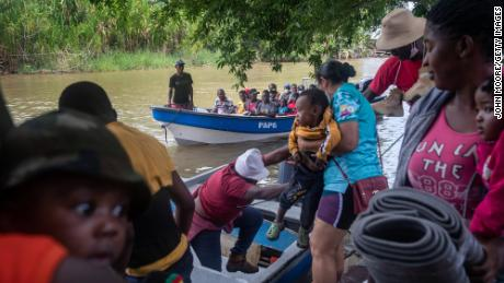 Haitian immigrants arrive by boat in Acandi, Colombia, to begin their overland journey through the Darien Gap into Panama and on towards the United States.