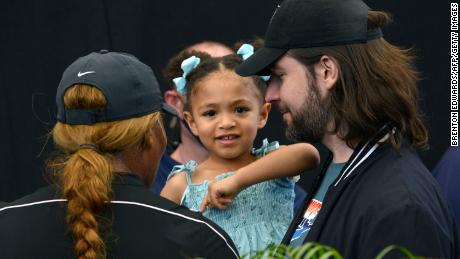 Serena Williams (L) and her husband Alexis Ohanian talk to their daughter Alexis Olympia Ohanian Jr during the 'A Day at the Drive' exhibition tournament in Adelaide on January 29, 2021.