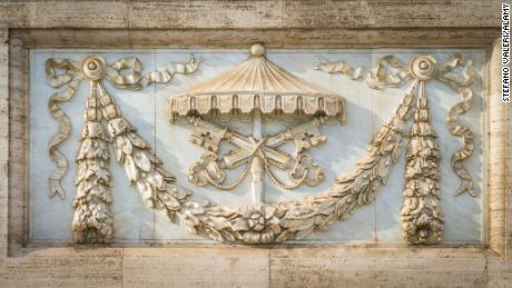The arms of the holy sea on the facade of the basilica of Saint John Lateran in Rome in Nov 2017.