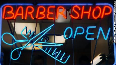 New York barbershops and salons are open.  It does not mean business as usual