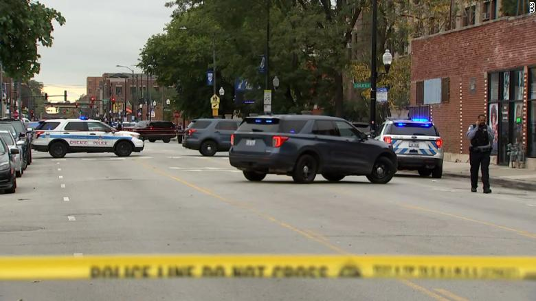A Chicago teenager and security guard were shot at a high school, police say