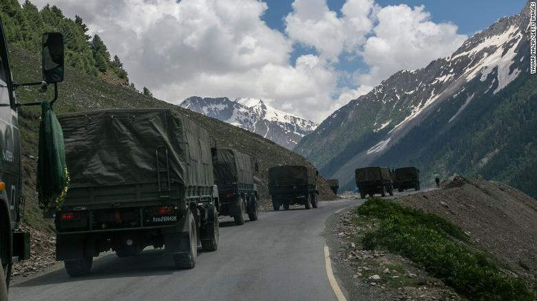 An Indian army convoy travels through Zoji La, a high mountain pass bordering China on June 13 in Ladakh, India.
