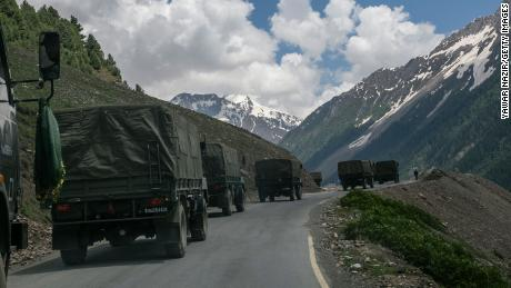 An Indian army convoy crosses Zoji La, a high mountain pass bordering China, on June 13 in Ladakh, India.