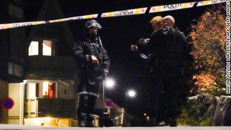 Police officers cordon off the scene in Kongsberg on October 13.