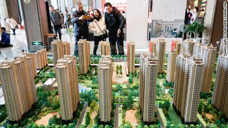 Chinese homebuyers looking at housing models of a residential property project in Huai'an city, Jiangsu province, China, on Dec. 23, 2018.