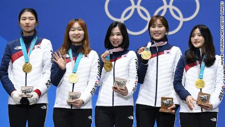 South Korean skaters celebrate gold in the women's 3,000m relay at the 2018 Winter Olympics.