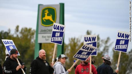 Strikers picket outside the John Deere factory in Davenport, Iowa, on the first day of the strike Friday.