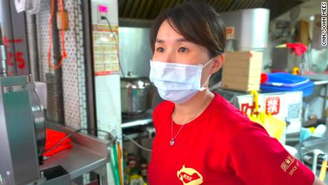 Vicky Tsai, a pork seller in Taipei, said China and Taiwan had managed to live peacefully together for the past 70 years.