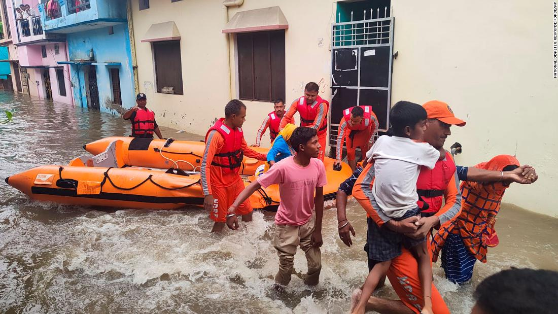 Floods and landslides kill at least 150 in India and Nepal