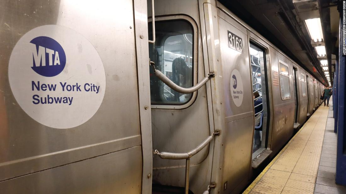 Unmasked NYC police officers forcibly remove masked subway commuter in video
