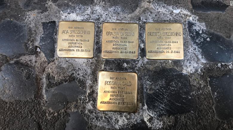 Gold cobblestones outside front doors in Rome's Jewish Ghetto commemorate people arrested and deported to Auschwitz. Two-year-old Rossana Calo was one of those.