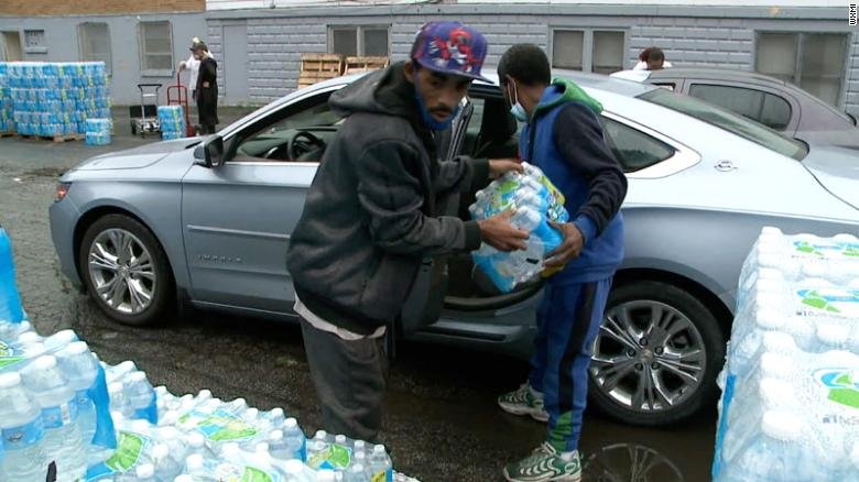 Residents of Benton Harbor, Michigan, pick up bottled water distributed by the state.
