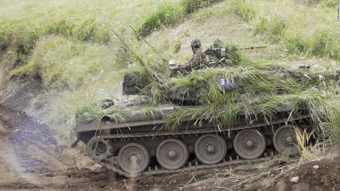 As regional tensions rise, Japan's ground troops hold their first military drills in decades