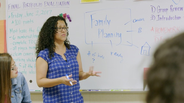 Health educator Leticia Jenkins discusses family planning with students at James Monroe High School in Los Angeles, Calif.